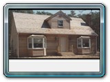 Brewster-red-cadar-clapboards-bay-windows