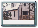 Brewster-red-cedar-clapboards-front-white-cedar-gable-stained-trim
