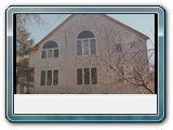 Brewster-white-cedar-shingles-circle-top-windows