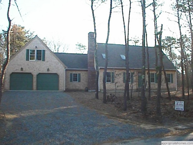 cape-with-ell-and-two-car-garage