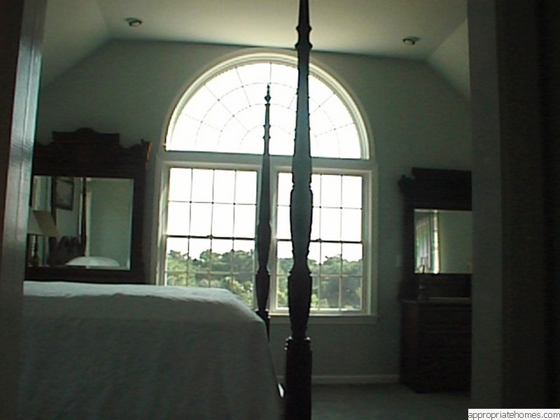 decorated-bedroom-with-arc-window