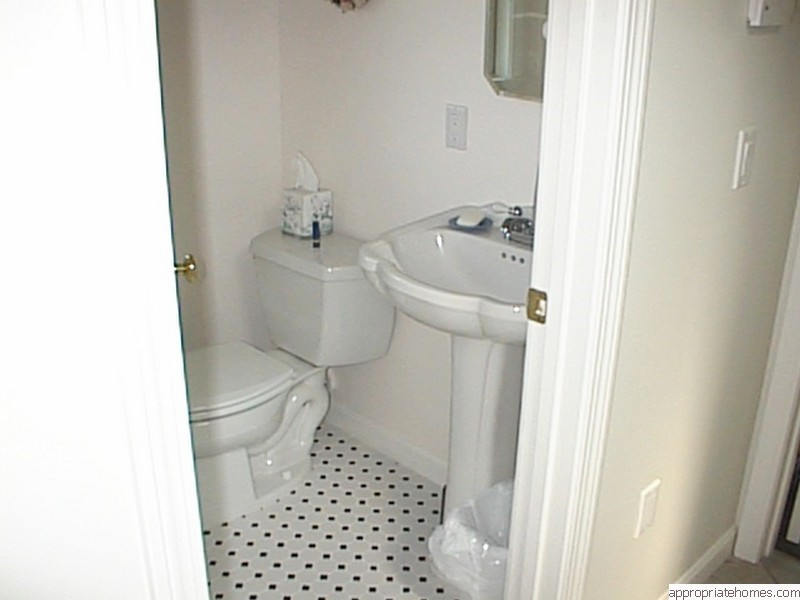 half-bath-with-tile-floors-with-dots
