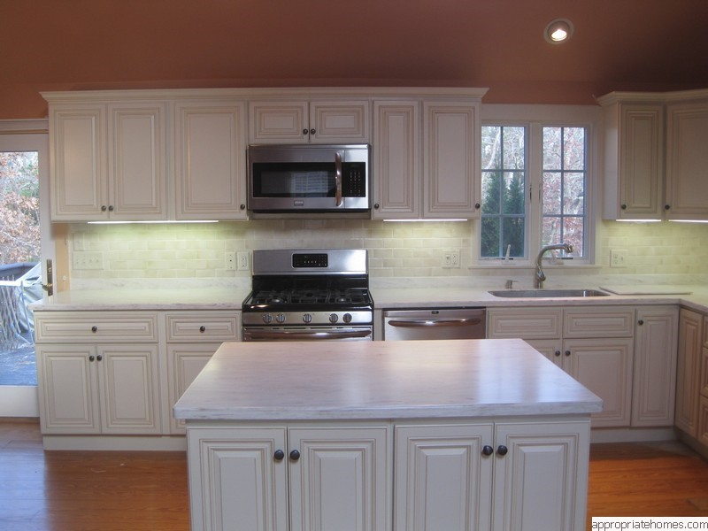 kitchen-with-island-and-corian-countertop