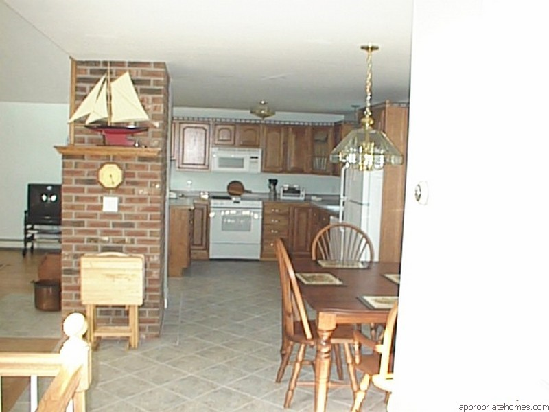 kitchen-with-oak-floor-brick-fireplace