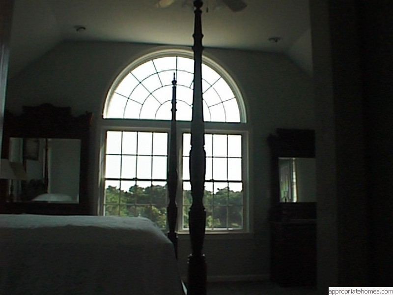 large-arc-window-in-bedroom