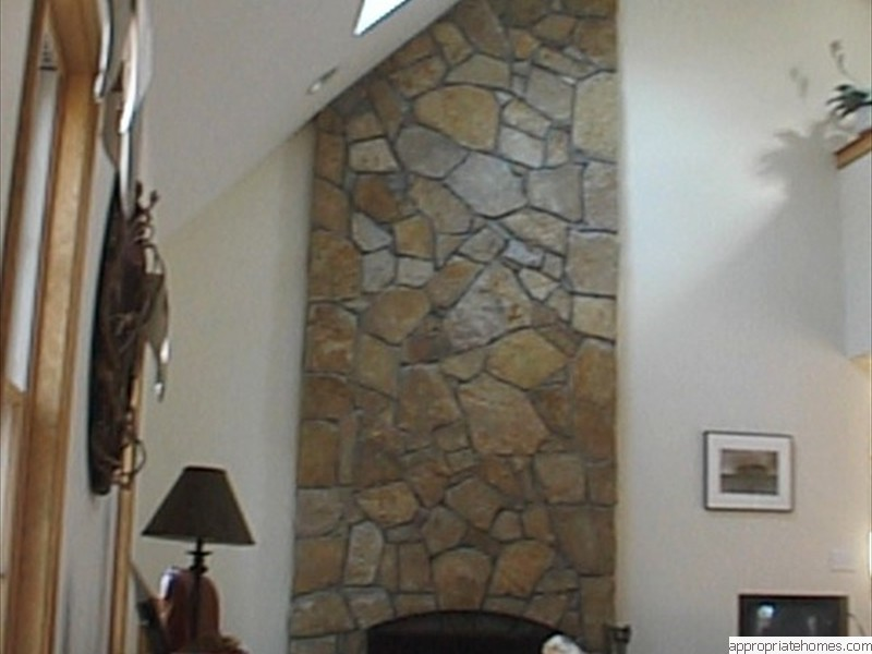 Chatham-livingroom-fireplace-stone